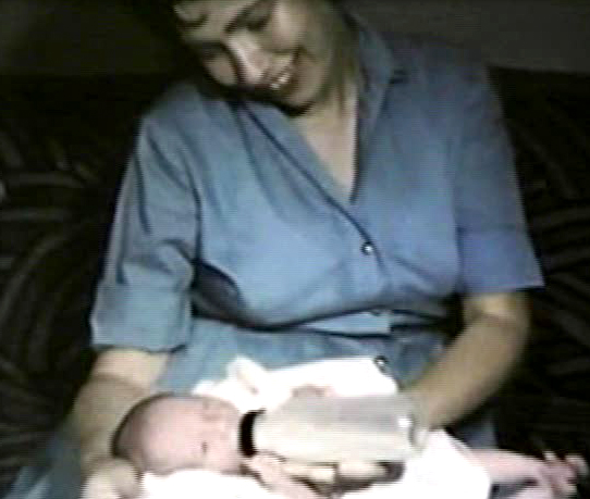 This is such an old picture taken from a home movie. I love the way my mother is looking at me!
