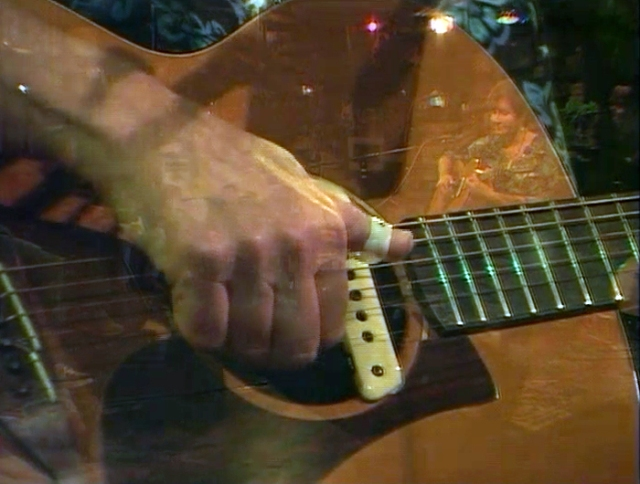This image is from a video of one of my performances at Kulak's Woodshed. Sometimes the video has images that overlap, and I can see myself playing in the refection.