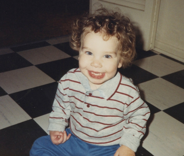 Jason sitting on the floor of the coop where I'm now living.He loved visiting his grandparents.