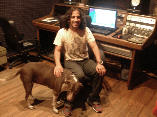 A picture of Darrin at the recording console with his dog nearby. She's never in the room when we record, though.