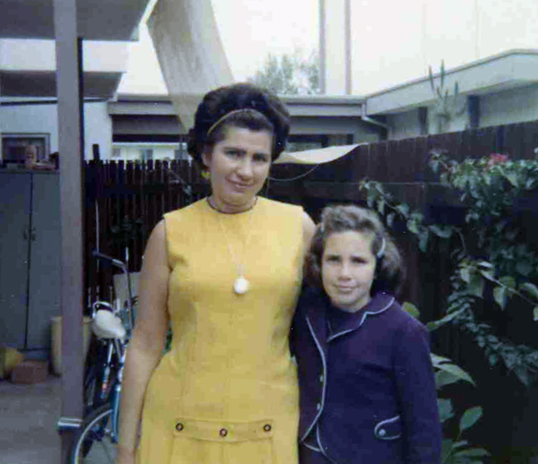 This picture of my mother and I was taken outside the coop where I am now living.