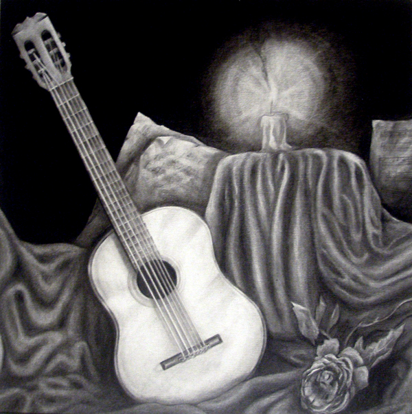This is a charcoal drawing from my college days. I played classical guitar back then.