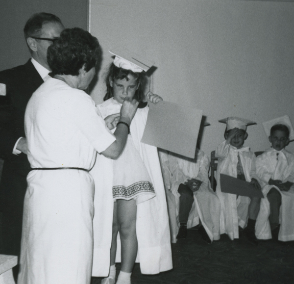 In this picture my mom is with me as I graduate preschool.