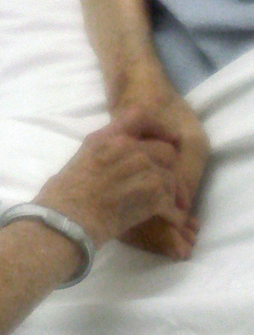 This picture is of my mother holding my father's hand as he was dying.