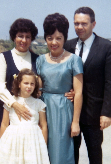 In this picture, I'm with my parents and Susan's mother is in the middle. I hated being dressed up, so maybe that's why I'm not smiling!