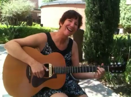 Playing my guitar in the garden
