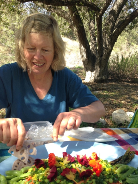 This past week, I went on a lovely hike and had a picnic with my good friend, Carol. Being with her lifted my spirits so much. In this picture, she is assembling a fantastic salad for our picnic lunch.