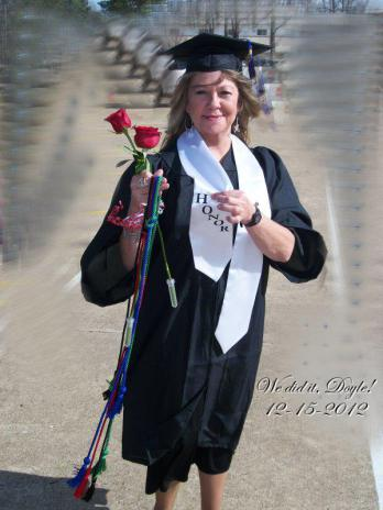 """This picture is from a teary story on Relinda's blog called """"The Promise."""" By graduating, she kept her promise that she made to her husband, Doyle shortly before he died. Notice the inscription on the right side of the photo."""
