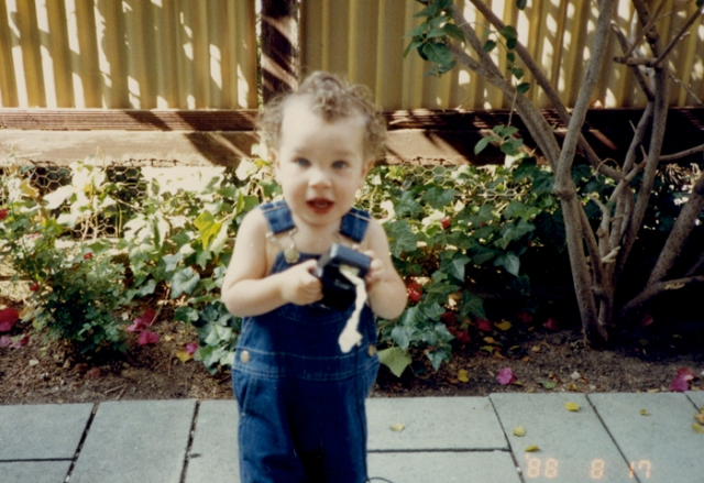 This picture was taken when Jason was about 3 and visiting his grandparents. I am living in my parents' coop now. I am a song gardener only, which will be clear in the picture that follows showing the current state of my backyard!