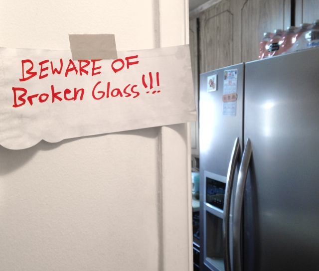 "I share my ""castle"" with my two sons. I'm glad my youngest son put up this sign after breaking a jar, but he could have done a better job sweeping up the glass."