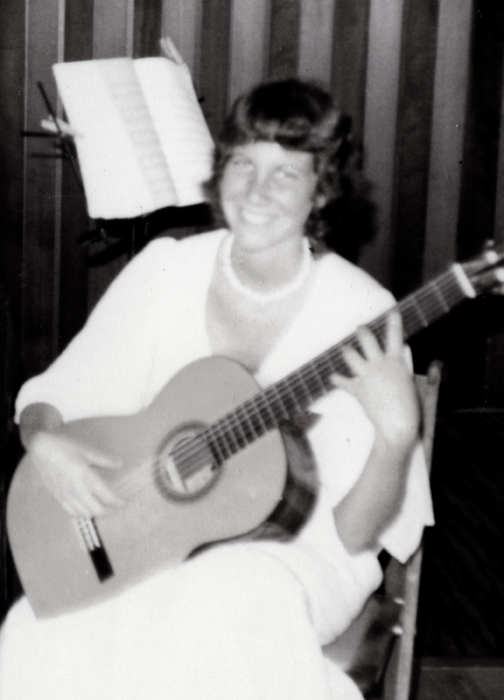 That's me playing my old classical guitar at the age of 17! Below is that same guitar in my daughter's hands.