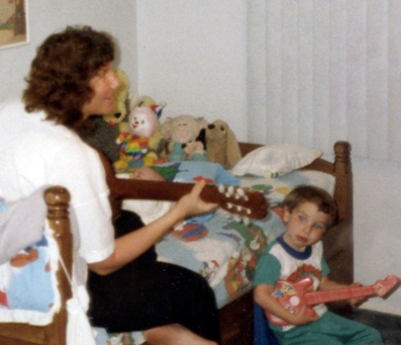Guitar with Jason on his bed