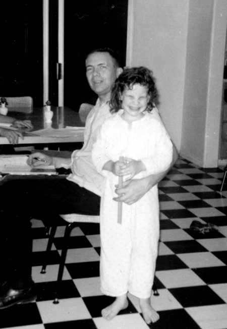 Seeing pictures of myself in the apartment where I'm now living is like time travel. This year, I replaced the black and white floor and love the new look. I'm wondering why I have such a scrunched up expression in this picture with my dad.
