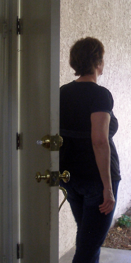 In this picture, I am standing looking out the door of my former house I lived in for almost twenty years.