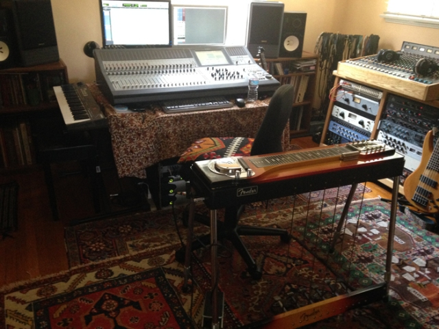 This is where I've been doing some new guitar recordings, as well as stories for an audio book. My engineer sits at the mixing board near the window when I am recording. Sometimes, the birds are chirping too loudly and he goes outside to shoo them away.
