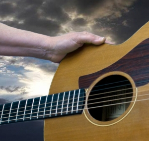 Guitar, hand and sky