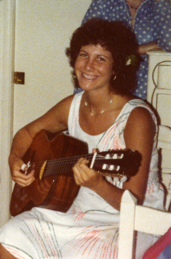 In this photo, I am playing my classical guitar at the age of twenty.