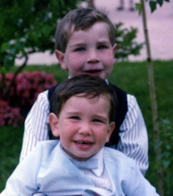 In this picture, Jason is holding his brother. Jason died five months after this picture was taken.